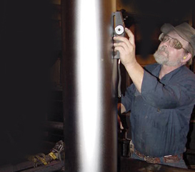 Technician inspecting roller finish